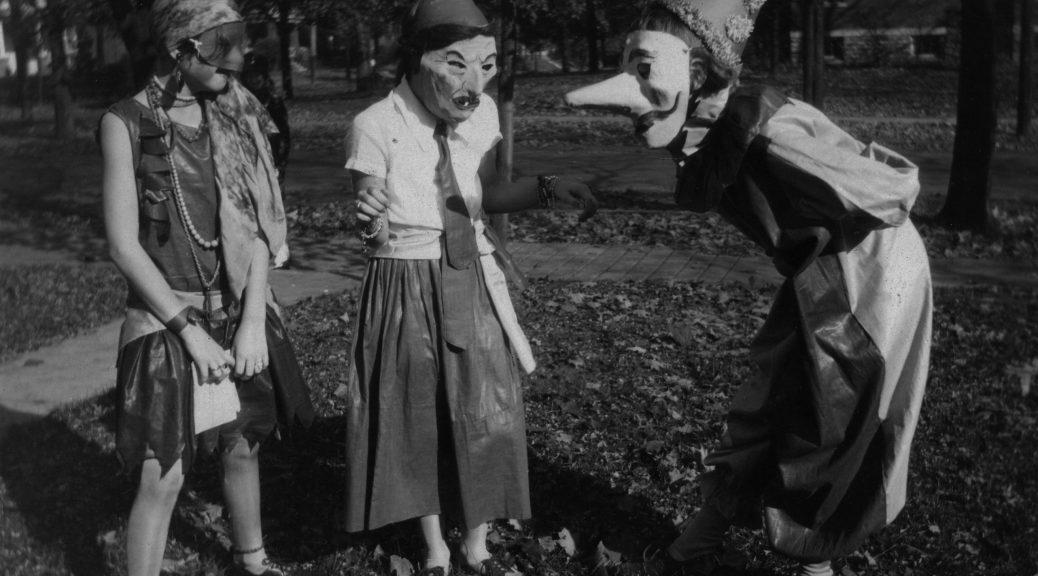 Three girls wearing masked costumes in Cincinnati, Ohio in1929.