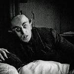 Count Orlok hovers over Ellen Hutter in Nosferatu (1922)