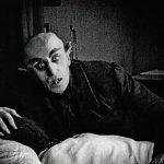 Count Orlok hovers over Ellen Hutter in Nosferatu (1922)