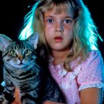 A young Drew Barrymore holds General, her savior, in Cat's Eye (1985)